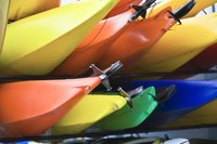 Bright colored kayaks stacked on each other