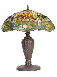 Tiffany lamps display Victorian motifs like elaborate floral designs and dragonflies.