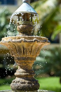 Keeping water fountains free of mineral buildup improves their appearance.
