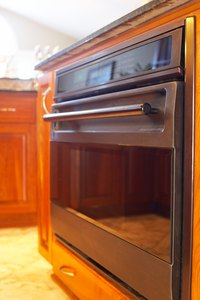 Clean spills from your oven glass promptly to avoid heavy buildup.