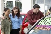 Use lots of colorful banners on your used car lot to draw attention to discounts and new offerings.
