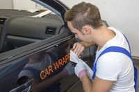 Some design shops specialize in creating and placing vinyl car wraps.