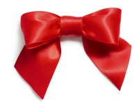 Make a fabric bow to decorate yourself or your home.