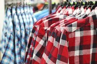 Flannel shirts hanging in clothing store.