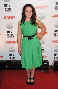 Amara Miller wears an emerald green dress at AARP's 11th Annual Movies for Grownups Awards Gala in Beverly Hills, in 2012.
