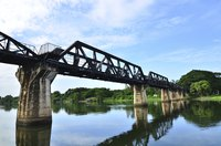 Trains cross the historic River Kwai in Thailand.
