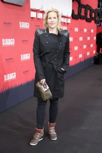 "Annika Decker wears skinny jeans and high top sneakers at the ""Django Unchained"" Berlin Premiere in 2013."