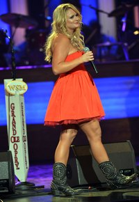 Miranda Lambert wears cowboy boots with a dress at The Grand Ole Opry in Nashville, Tn. in 2012.