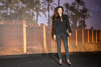 Actress Monica Bellucci pairs a shapely blazer with fitted gray slacks for a sexier take on business attire.