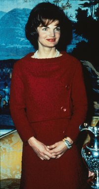 Jacqueline Kennedy wore a two-piece Chez Ninon dress during a televised Valentine's Day tour of the White House in 1962.
