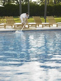 A pool skimmer makes oil clean-up easier.