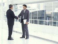 Two businessmen shaking hands in a modern office