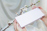 Image of a woman opening an invitation.