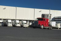 Trucks are docked at shipping bays.