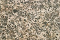 Place granite tiles together to make a seamless-looking surface.
