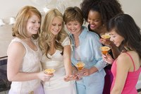 Woman looking at engagement ring at bridal shower.