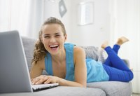 Woman smiling at home on laptop