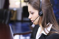 Customer service employees on telephone headset.
