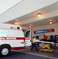 An ambulance is backed up to a hospital door.