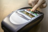 Image of a credit card scanner at a retail store or business.