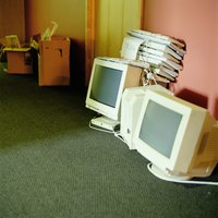 Old computers and monitors on the floor