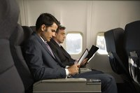 Businessman sitting on an airplane