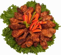 Chicken wings can be re-fried if they haven't been coated in sauce, batter or breadcrumbs.