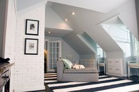 A vaulted ceiling makes a room seem bigger.