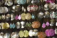 Rows of earrings.