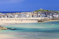 Coastal towns such as St. Ives draw in hordes of tourists over the summer.