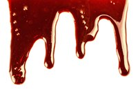 Strawberry and chocolate syrups team up for fake blood.