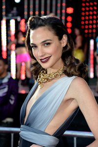 Actress Gal Gadot pairs a chunky gold necklace with a plunging neckline.