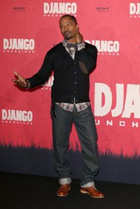 Actor Jamie Foxx pairs a bow tie with jeans and chunky Oxfords.