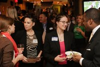 Guests attending an event to raise funds for business growth in a city.