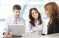 Employees showing research to company principal
