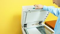 How to Empty Punch Waste on a Sharp Copier