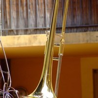 What materials are used to make a trombone?
