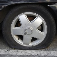 How to Remove the Lower Spare Tire From a TrailBlazer | eHow
