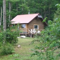 Secluded solitary cabins in arkansas for Lake texoma cabins with hot tub
