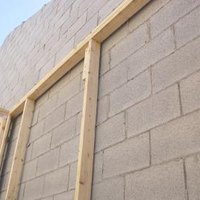 Poured walls vs concrete block with pictures ehow for Poured concrete walls vs block cost