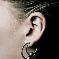 how to clean cartilage piercing with saline solution
