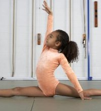 A split is a stretch that completely extends the legs so that they and the base of the torso are flat on the ground. You can do a split with your ...