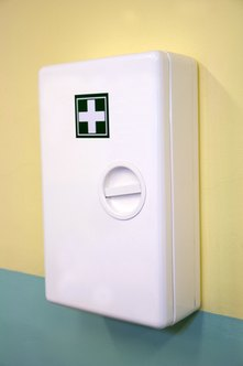 The first aid kit should be placed in an easily accessible location with clear labeling.