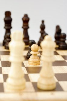 Business is like a chess game with the strategic goal of winning and tactical manouvers designed to combat the opponent's pieces.