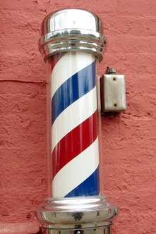 The barber pole is a traditional indicator of a barbershop's presence.