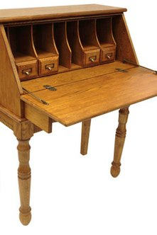 Pullout secretary desks are space savers in small offices.