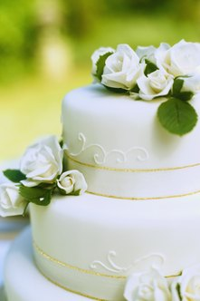 Cake designers may be in the business of creating wedding cakes.