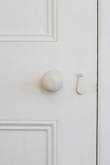 Mulitple colors of paint, sanded, give a plain door an antique look.