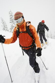 Use your body weight as well as your height to properly fit cross-country skis.