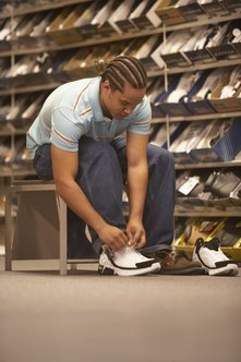 Financing a shoe store business requires additional items besides initial shoe inventory.